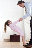 Girl standing on Dad's feet