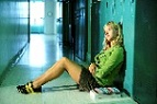 Teen girl in school hallway photo