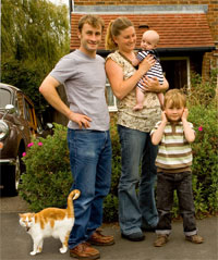 A photograph of a family and their cat