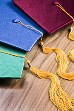 Three colorful graduation mortarboards with tassels