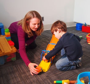 Photo of mother and child engaged in therapy activity