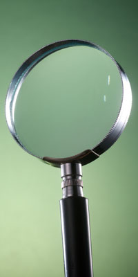 Photo of magnifying glass illustrating article about hunting for clues to autism through Autism Family Biobank research