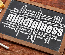 "tablet with word ""mindfulness"" illustrating study about mindfulness training to reduce stress"