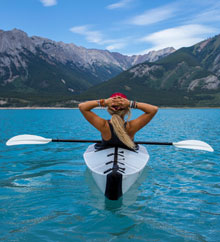 Photo of woman relaxing on kayak