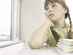 Photo of inattentive girl staring out window in autism and ADHD article