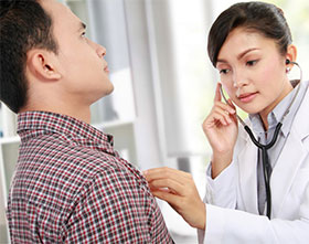 photo of doctor examining man