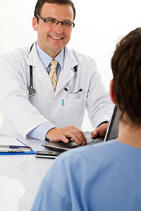 photo of young adult talking with doctor