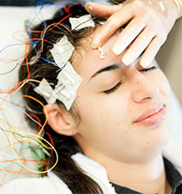 photo of young woman having an EEG test
