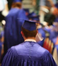 Photo of young man in cap and gown graduating, for article on transition for adults with autism