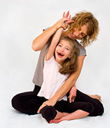 Photo of mother and daughter doing yoga for article on autism parenting