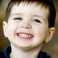 photo of smiling boy, illustrating lost diagnosis of autism