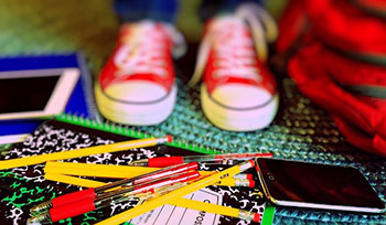 Photo of shoes and school supplies by Pixabay