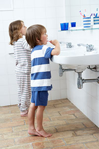 iStock photo of children brushing their teeth