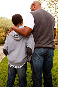 iStock photo of father and son talking and walking
