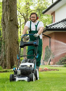 photo of landscaping employee mowing grass
