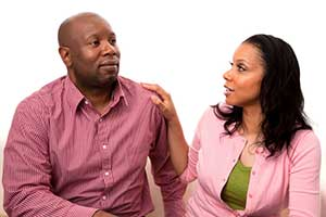 photo of married couple deep in conversation, illustrating article on divorce rate among parents of children with autism