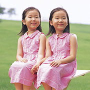 Photo of twin girls holding hands illustrating autism twins study