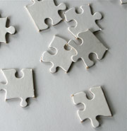 photo of white puzzle pieces to illustrate problem of diagnosing behavior in autism